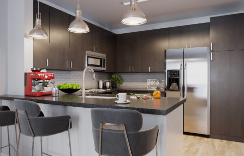 gourmet kitchen with front control gas range, double-door refrigerator and quartz countertops