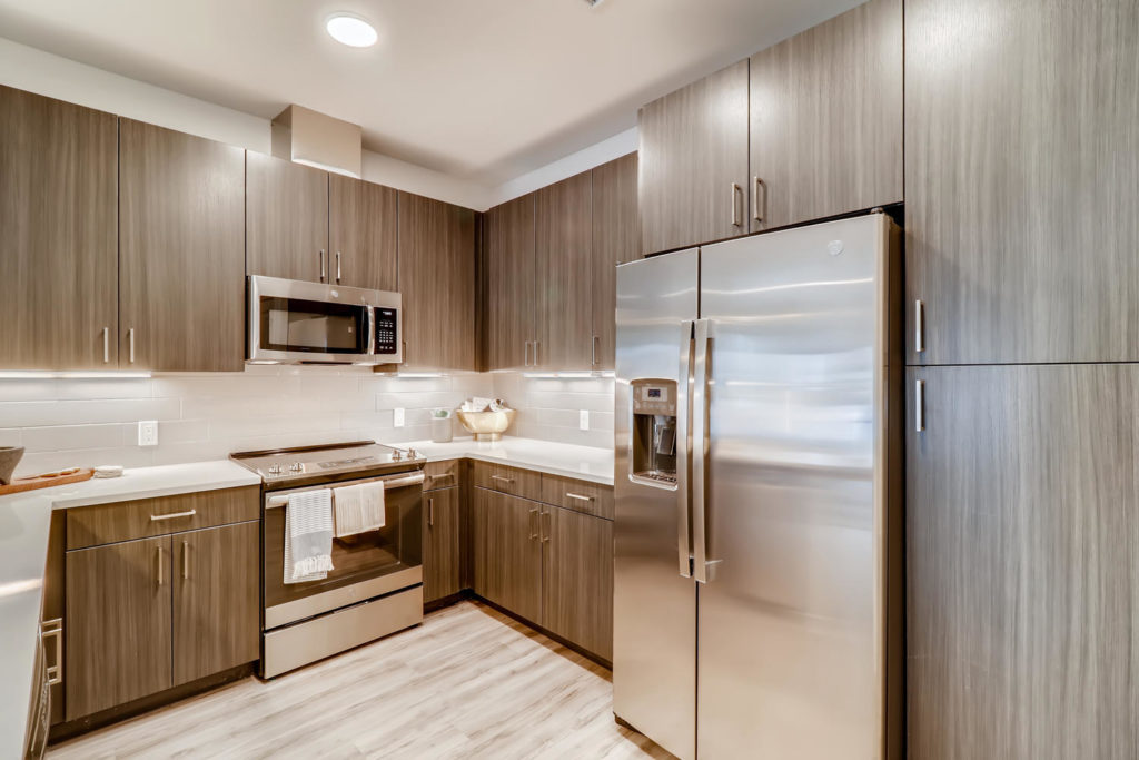 gourmet kitchen featuring stainless steel appliances at Alexan Diagonal Crossing - The Sky's the Limit in Boulder
